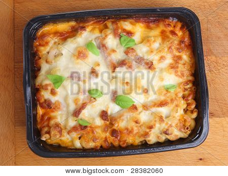 Freshly baked family-sized pasta ready meal with chicken, bacon and cheese.