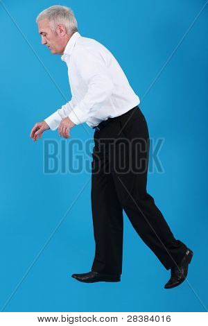 Businessman taking faltering steps