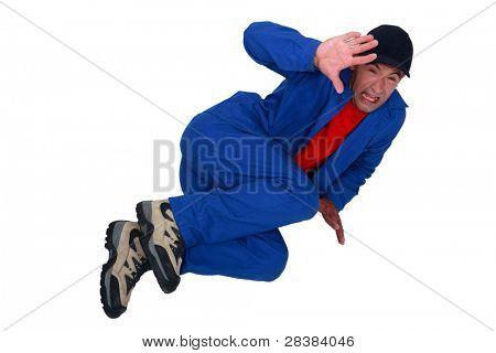Terrified man lying on the floor