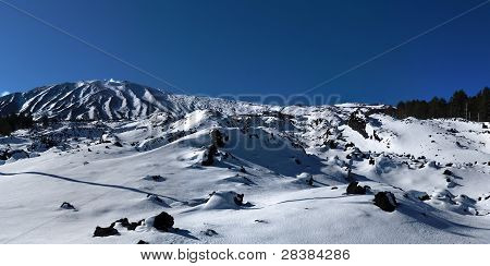 Lava field covered with snow in winter on Etna volcano Sicily
