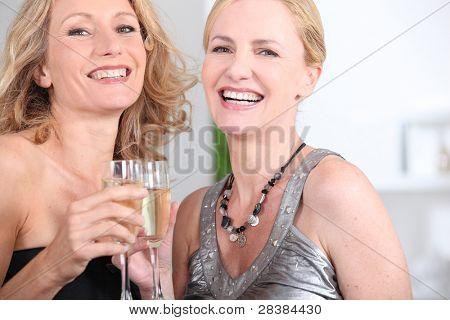 two women drinking champagne
