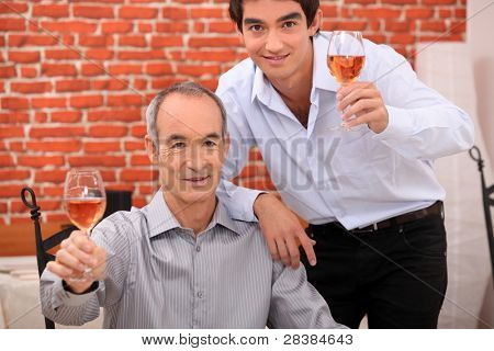 Men raising their glasses in a toast