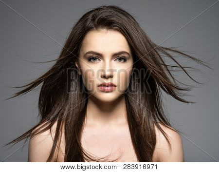 poster of Brunette woman with beauty long brown hair. Fashion model with long straight hair. Fashion model pos