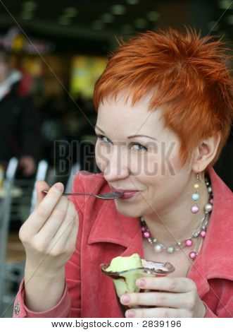 Woman Eating Ice Cream In Cafe And Smiling Happy