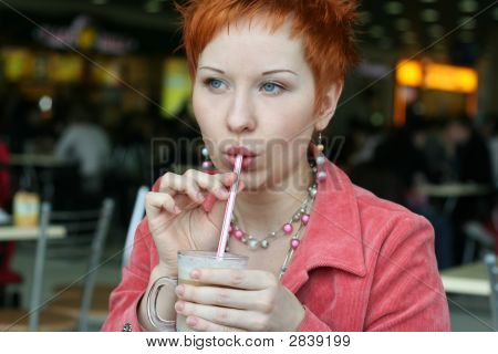 Woman Dreanking Coffe In Cafe And Smiling Happy