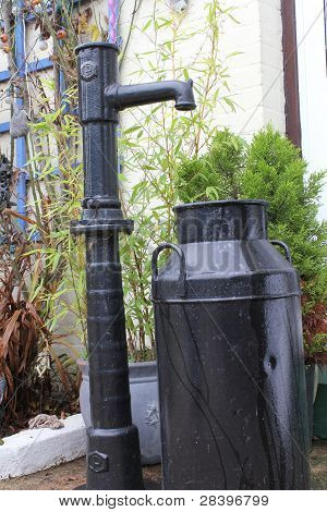 Old waterpump and churn