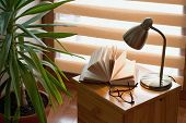 Book An Lamp On The Table, Window Background, Cozy Home Still Life With Lamp poster