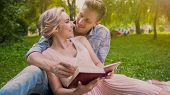 Happy Couple Sitting On Rug Reading Book And Tenderly Looking At Each Other, Stock Footage poster