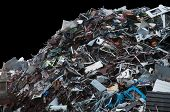 Mountain Of Discarded Trash On A Black Background poster