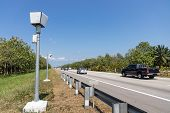 Speed Trap Surveillance Camera Along Highway To Control Speeding poster