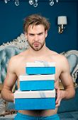 Man In Luxury Bedroom With Gift Box. Man Handsome Lover And Gift. Surprise For Sweetheart. Gifts For poster