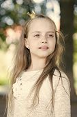 Girl Kid On Calm Face With Tiny Golden Crown On Head, Nature Background, Defocused. Princess Concept poster