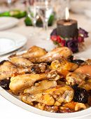 chicken thighs on a plate with dried peaches, apples and prunes
