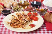 Spicy grilled chicken skewer with ketchup, mustard and mayonnaise poster