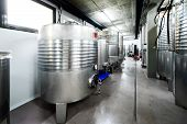 Inox Wine Barrels Stacked In Modern Winery Cellar In Spain. poster