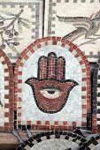 stock photo of hamsa  - Fatima hand on the ceramic tile - JPG