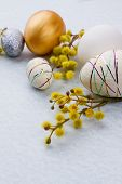 Easter Eggs And Spring Flowers. Styrofoam Festive Easter Eggs And Pussy Willow Twig On Light Blue Ba poster