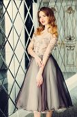 A portrait of a beautiful elegant woman in the evening dress. Fashion, evening dresses for events. poster