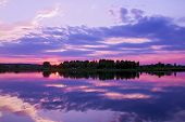 Panorama Reflection Of Sunset In The Water Of The Lake. The Sky And Clouds, Illuminated By The Sun S poster