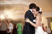 image of grossed out  - Just married couple dancing in front of their unrecognizable friends - JPG