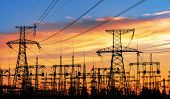 High-voltage  Power Lines. Electricity Distribution Station. High Voltage Electric Transmission Towe poster