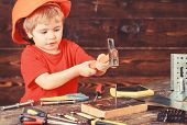 Handcrafting Concept. Toddler On Busy Face Plays With Hammer Tool At Home In Workshop. Kid Boy Play  poster