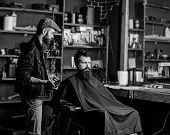 Barber Styling Hair Of Bearded Client With Comb And Clipper. Hipster Client Getting Haircut. Haircut poster