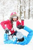 stock photo of snowball-fight  - Winter couple snowball fight - JPG