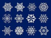 stock photo of kirigami  - a set of 12 white snowflakes kirigami on a dark background - JPG