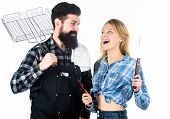Tools For Roasting Meat Outdoors. Picnic And Barbecue. Man Bearded Hipster And Girl Ready For Barbec poster