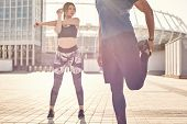 Warming Up Together. Close Up View Of Sporty And Healthy Couple Standing Outside And And Warming Up  poster