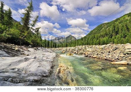 Mountain River and monolithic stone beach