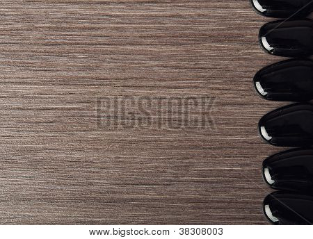 Spa Background And Frame. Black Stones On Wooden