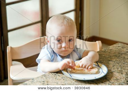 Cute Baby Boy Eating Breakfast