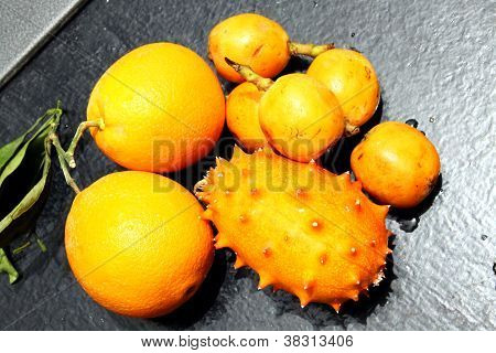 Exotic Fruits: Orange, Kiwano And Loquat