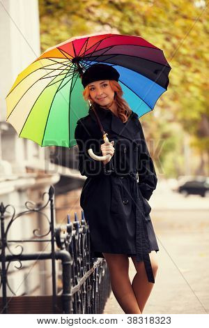 Single Girl With Umbrella At The Street.