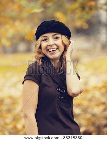 Redhead girl in the autumn park.