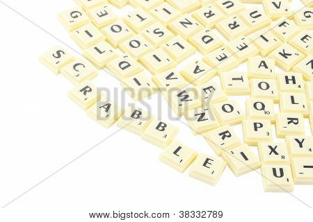 Scrabble yellow piece block on white background.