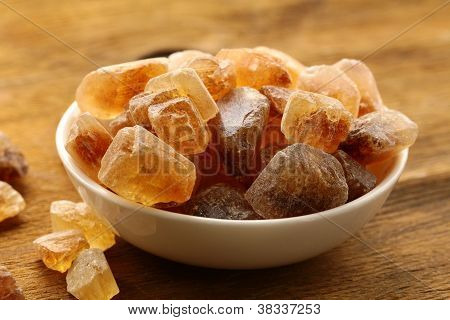 Rock candy sugar on a wooden table