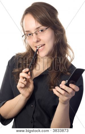 Attractive Secretary Holding A Pencil And A Cellphone