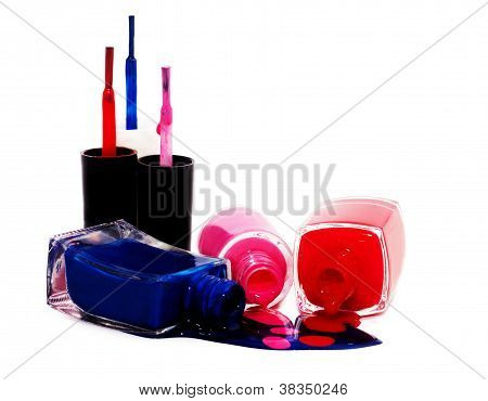 Red Pink And Blue Nailpolish Isolated On White
