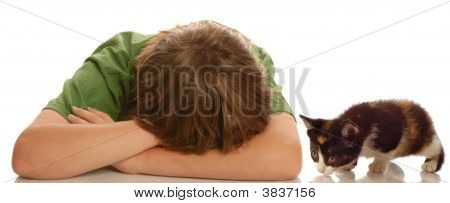 Depressed Teen With Head Down With Kitten