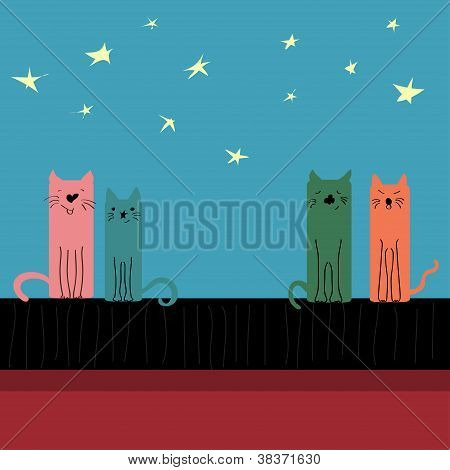 Colored cats sitting on the roof