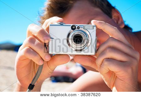 Digital Compact Photocamera In Hands