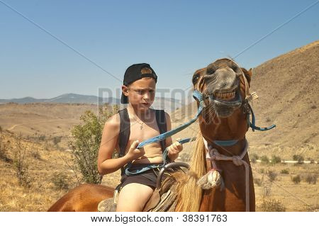 Boy Tames A Horse.