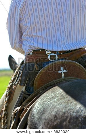 Cowboy And His Saddle