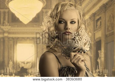 Blonde Girl With Silver Mask Looks At Right
