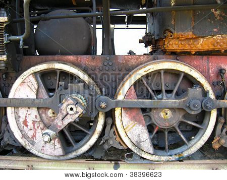wheels of an ancient steam locomotive