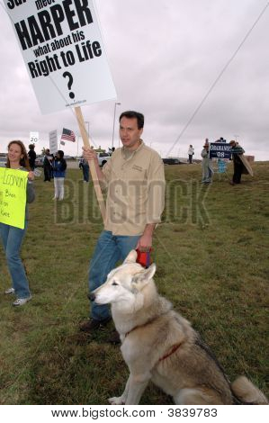 Man And Wolf Hybrid Protesting At A Palin Rally