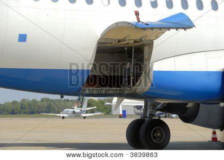 Airplane With Open Cargo Door